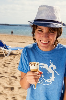boy eating ice cream on beach